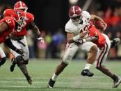 Alabama Crimson Tide quarterback Tua Tagovailoa rushing the ball against the Georgia Bulldogs in the College Football Playoff National Championship game