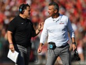 Ohio State Buckeyes head coach Urban Meyer talks with defensive coordinator Greg Schiano during a timeout against the Indiana Hoosiers
