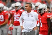 Ohio State head coach Urban Meyer watches his team warm up against the Tulane Green Wave
