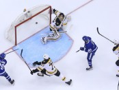 Toronto Maple Leafs center William Nylander scoring a goal against the Boston Bruins