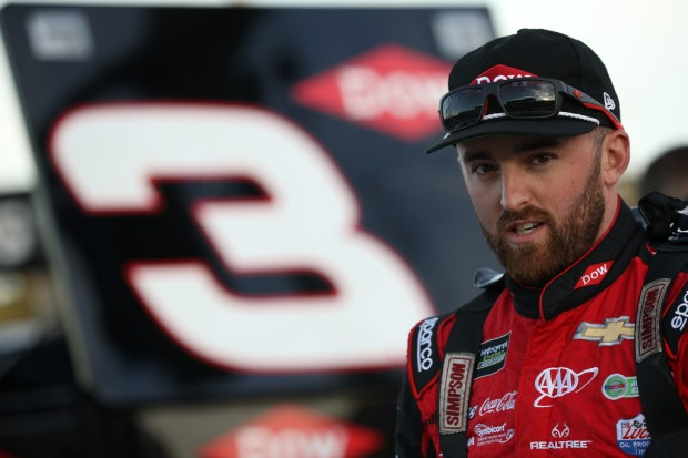 Monster Energy NASCAR Cup Series driver Austin Dillon stands on the grid during qualifying at the Hollywood Casino 400