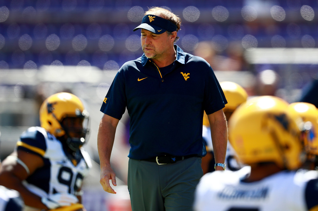 Former West Virginia Mountaineers head coach Dana Holgorsen looks on during warm-ups against the TCU Horned Frogs