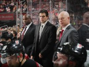 New Jersey Devils head coach John Hynes looks on with his coaching staff against the Colorado Avalanche