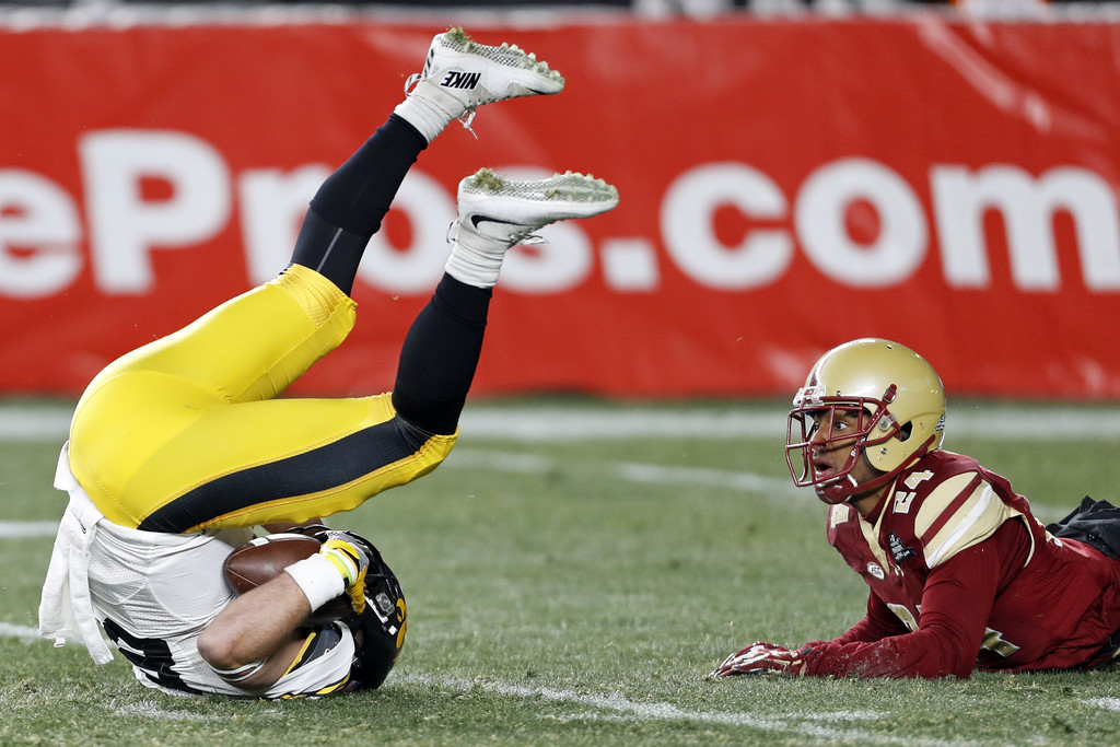 Iowa Hawkeyes wide receiver Nick Easley makes a reception in front of Boston College Eagles' Taj-Amir Torres