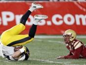 Iowa Hawkeyes wide receiver Nick Easley makes a reception in front of Boston College Eagles' Taj-Amir Torres