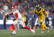 Kansas City Chiefs quarterback Patrick Mahomes runs from being tackled against the Los Angeles Rams