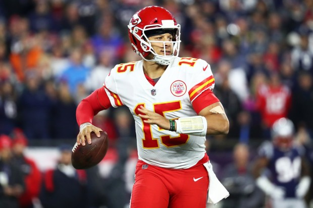 Kansas City Chiefs quarterback Patrick Mahomes attempts a pass against the New England Patriots