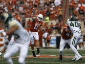 Texas Longhorns quarterback Sam Ehlinger attempts a pass against the Baylor Bears