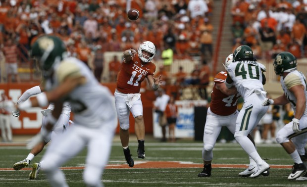Texas Longhorns quarterback Sam Ehlinger attempts a pass against the Baylor Bears