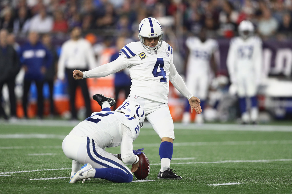 Indianapolis Colts kicker Adam Vinatieri attempts a 38-yard field goal against the New England Patriots