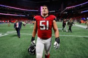 Atlanta Falcons center Alex Mack walking off the field against the Dallas Cowboys