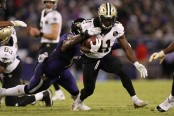 New Orleans Saints running back Alvin Kamara running the ball against the Baltimore Ravens