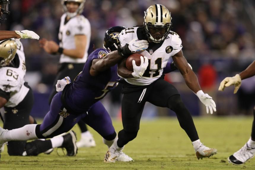 New Orleans Saints running back Alvin Kamara running the ball against the Baltimore Ravens