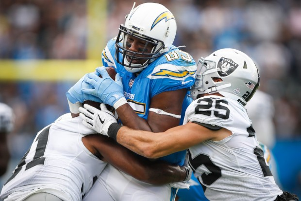 Los Angeles Chargers tight end Antonio Gates is tackled after making a reception against the Oakland Raiders