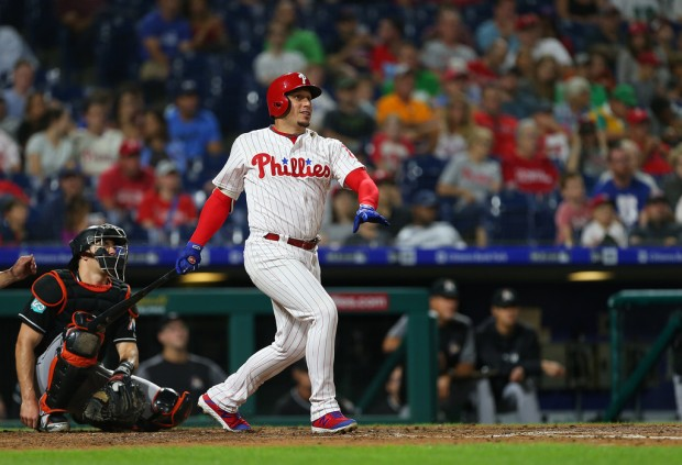 Former Philadelphia Phillies infielder Asdrúbal Cabrera hits a double against the Miami Marlins