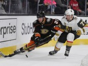 Former Vegas Golden Knights defenseman Brad Hunt skates against Chris Wagner for the puck against the Anaheim Ducks