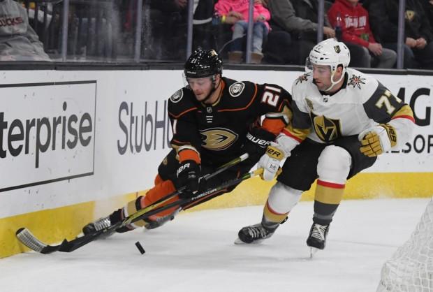 Former Vegas Golden Knights defenseman Brad Hunt skates against Chris Wagner for the puck against the Anaheim Ducks