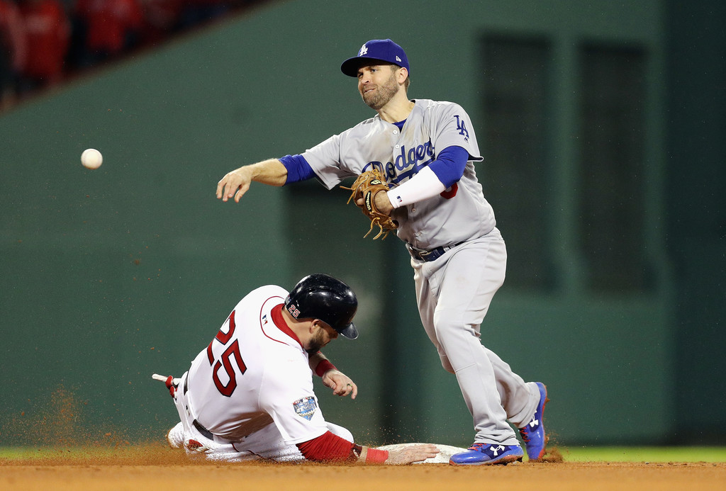 Former Los Angeles Dodgers second baseman Brian Dozier fails to turn a double play against the Boston Red Sox in the 2018 World Series