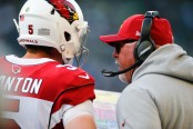 Former Arizona Cardinals head coach Bruce Arians talking to Drew Stanton in an NFL game against the Seattle Seahawks