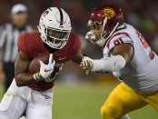 Former Stanford Cardinal running back Bryce Love runs the ball against the USC Trojans