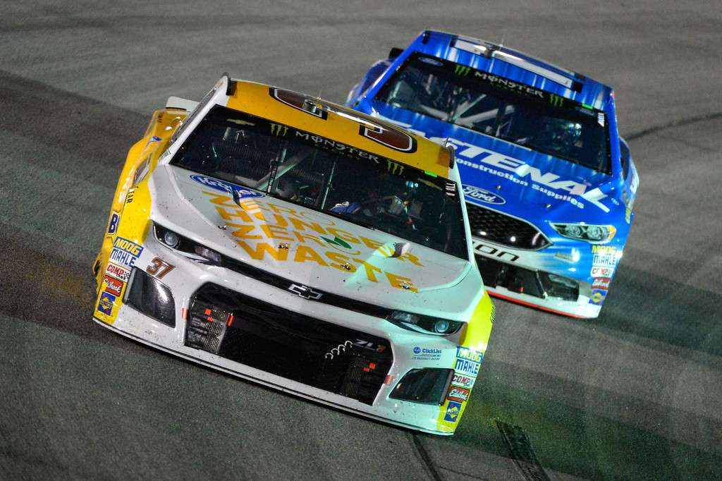 Monster Energy NASCAR Cup Series driver Chris Buescher leads Ricky Stenhouse Jr. during the Federated Auto Parts 400