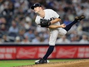 Former New York Yankees pitcher David Robertson pitching against the Boston Red Sox in the 2018 MLB Playoffs