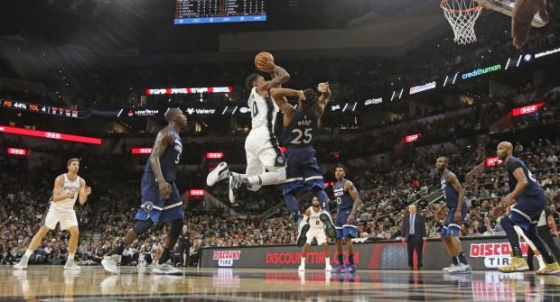 San Antonio Spurs star DeMar DeRozan shoots the ball against the Minnesota Timberwolves