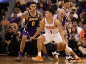 Phoenix Suns star Devin Booker handles the ball as Kyle Kuzma plays defense against the Los Angeles Lakers