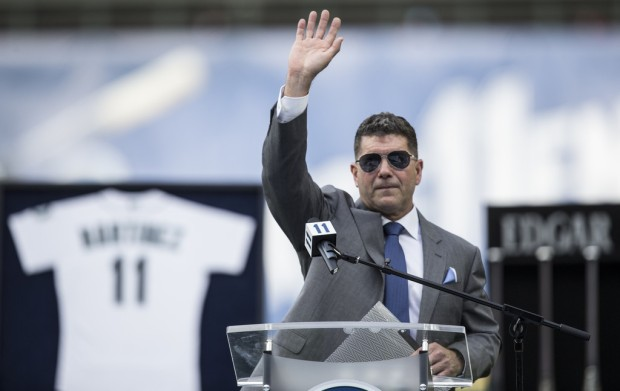 Former Seattle Mariners designated hitter Edgar Martínez acknowledges the crowd after his jersey retirement ceremony