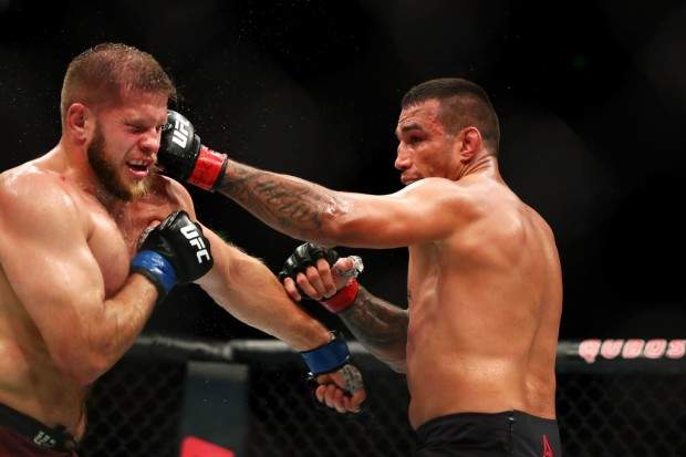 MMA Fighter Fabricio Werdum punches Marcin Tybura during their heavyweight bout at UFC Fight Night