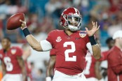 Former Alabama Crimson Tide quarterback Jalen Hurts warms up against the Oklahoma Sooners in the College Football Playoff