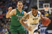 West Virginia Mountaineers guard James Bolden drives to the basket against the Marshall Thundering Herd in the 2018 NCAA Men's Basketball Tournament