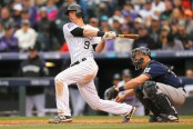 Colorado Rockies second baseman D.J. LeMahieu hits a double against the Milwaukee Brewers in the 2018 MLB playoffs