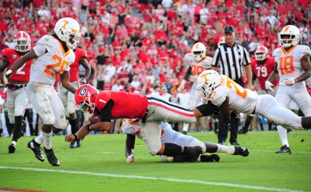 Former Georgia Bulldogs quarterback Justin Fields scores a touchdown against the Tennessee Volunteers