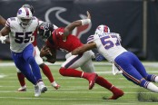 Buffalo Bills linebacker Lorenzo Alexander attempting to tackle Deshaun Watson against the Houston Texans