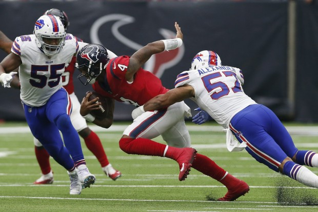 Buffalo Bills linebacker Lorenzo Alexander attempting to tackle Deshaun Watson against the Houston Texans