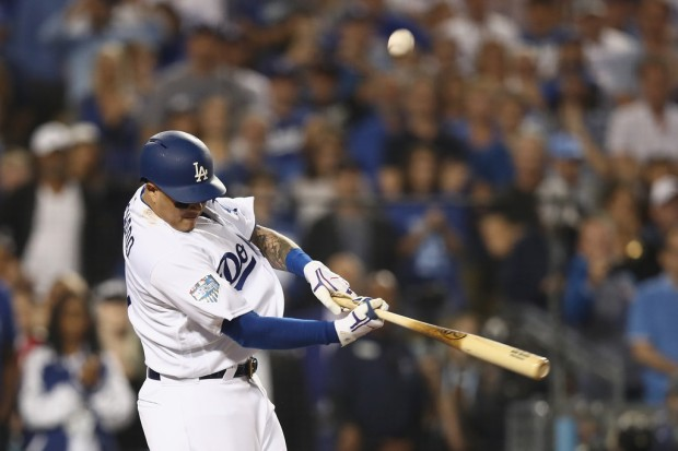 Former Los Angeles Dodgers infielder Manny Machado flies out against the Boston Red Sox in the 2018 World Series