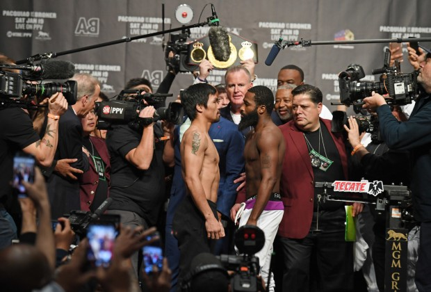 WBA welterweight champion Manny Pacquiao and Adrien Broner face off after their official weigh in at the MGM Grand Garden Arena