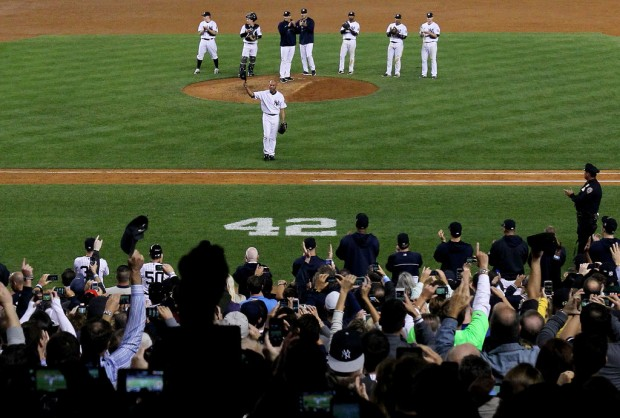 Former New York Yankees closer Mariano Rivera waves to the crowd after leaving the field against the Tampa Bay Rays