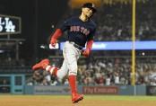 Boston Red Sox outfielder Mookie Betts celebrates a sixth inning home run against the Los Angeles Dodgers in the 2018 World Series