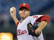 Former Philadelphia Phillies pitcher Roy Halladay delivers a pitch against the Miami Marlins