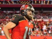 Tampa Bay Buccaneers quarterback Ryan Fitzpatrick runs out of the locker room against the Pittsburgh Steelers