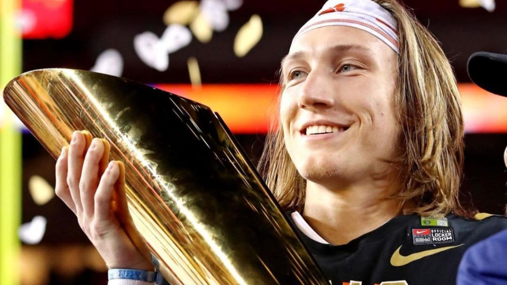 Clemson Tigers quarterback Trevor Lawrence holds the College Football Playoff National Championship Trophy after the Tigers defeated the Alabama Crimson Tide