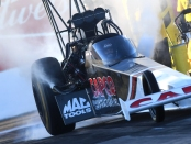 Capco Contractors/Torrence Racing Top Fuel Dragster pilot Billy Torrence racing on Saturday at the Magic Dry Organic Absorbent NHRA Arizona Nationals