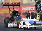 Capco Contractors/Torrence Racing Top Fuel Dragster pilot Billy Torrence racing on Sunday at the Magic Dry Organic Absorbent NHRA Arizona Nationals