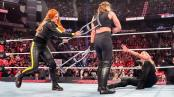 Wrestler Becky Lynch attacks Ronda Rousey after her Elimination Chamber win over Ruby Riott