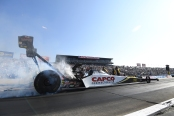 Top Fuel Dragster pilot Steve Torrence racing on Sunday at the Auto Club NHRA Finals
