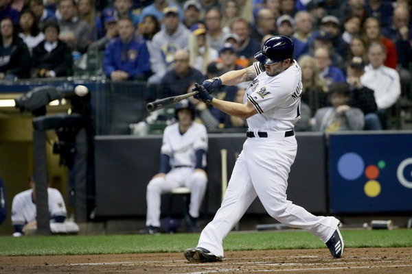 Former Milwaukee Brewers third baseman Mike Moustakas hits a single against the Los Angeles Dodgers in the 2018 playoffs