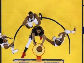 New Orleans Pelicans center Anthony Davis dunking the basketball against the Golden State Warriors