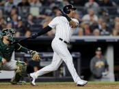 New York Yankees Outfielder Aaron Hicks hits a double against the Oakland Athletics in the 2018 AL Wild Card Game